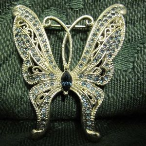 Jewelry - Silver tone butterfly pin with blue crystals